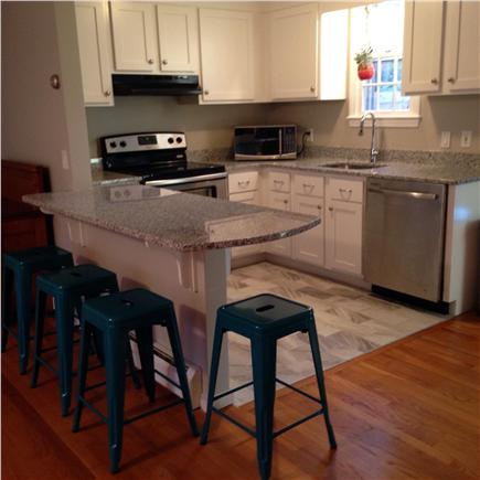 Falmouth Cape Cod vacation rental - A new kitchen includes granite countertops and ss appliances.