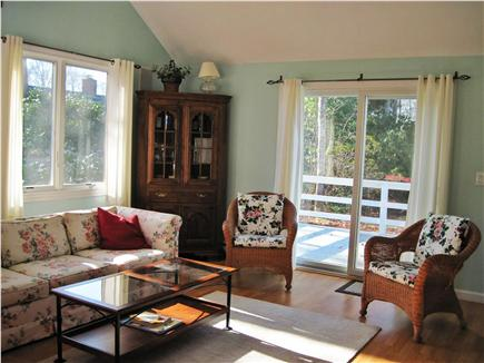 Falmouth Cape Cod vacation rental - The spacious family room has 2 sets of sliding glass doors.