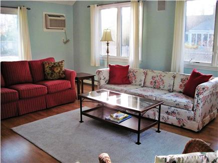 Falmouth Cape Cod vacation rental - The red sofa is a queen size sleeper sofa.