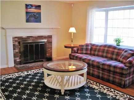 Falmouth Cape Cod vacation rental - The spacious living room has a working fireplace.