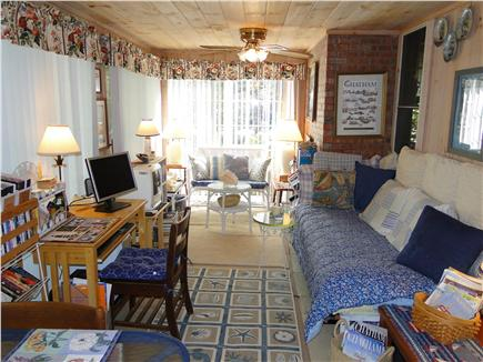 Chatham Cape Cod vacation rental - Three season room with TV, books, games, lounging, & celling fans