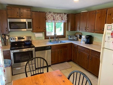 Eastham Cape Cod vacation rental - Well stocked kitchen has slider to deck, newer stove & microwave