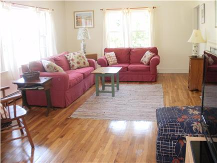 East  Sandwich-Sandy Neck Beac Cape Cod vacation rental - Spacious living room with a fireplace and comfortable furnishings