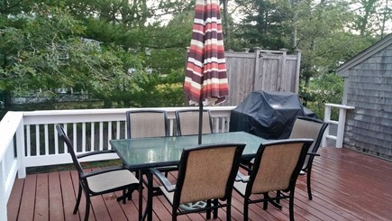 South Chatham Cape Cod vacation rental - Patio set & grill on large wrap around deck