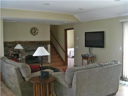 South Chatham Cape Cod vacation rental - Living room with fireplace and flatscreen TV