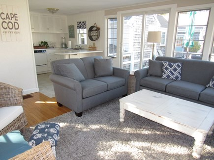 West Harwich Cape Cod vacation rental - Sunny family room with kitchenette, counter seating & SMART TV.