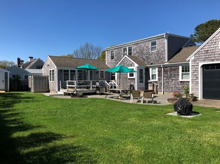 West Harwich Cape Cod vacation rental - Grill, shower, patio, fire pit, large yard & rustic garage w/ TV.