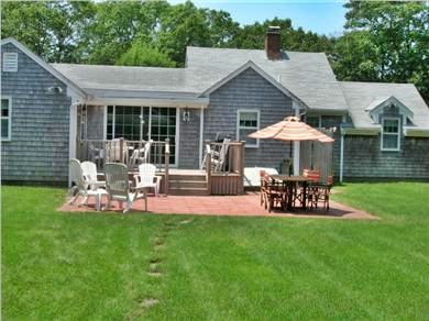 West Harwich Cape Cod vacation rental - View of deck and patio and outside shower from garden house