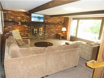 West Hyannisport Cape Cod vacation rental - Downstairs den, kids love to watch video here, adjacent patio