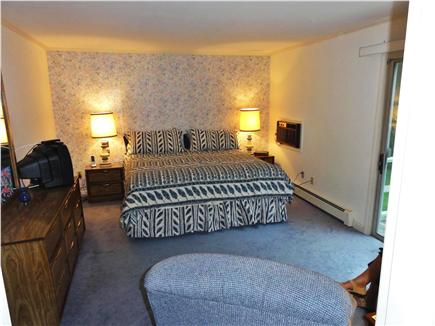 West Hyannisport Cape Cod vacation rental - Main floor bedroom with king bed, new flat TV, AC, exit to deck