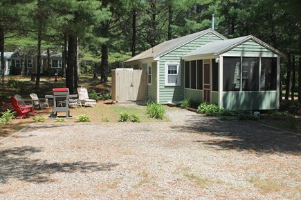 Chatham Cape Cod vacation rental - View of the cottage including the grilling area & outdoor shower