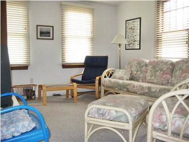 Eastham Cape Cod vacation rental - Flat screen TV. wall to wall carpet, rattan couch and chairs.