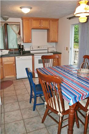 Eastham Cape Cod vacation rental - Kitchen area with access to deck facing East.