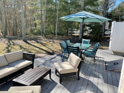 New Seabury, Mashpee, Poppones Cape Cod vacation rental - Deck: patio set, 6 person table, outdoor shower and gas grill
