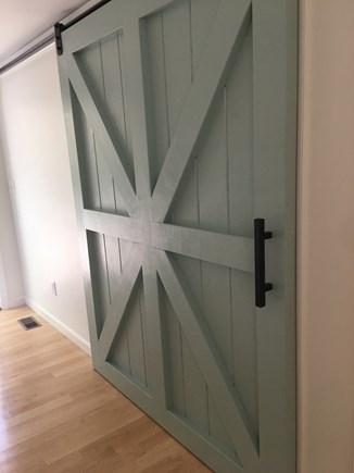 New Seabury, Mashpee, Poppones Cape Cod vacation rental - Barn Door: master bedroom