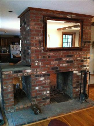 Brewster Cape Cod vacation rental - Double sided fireplace - living room view