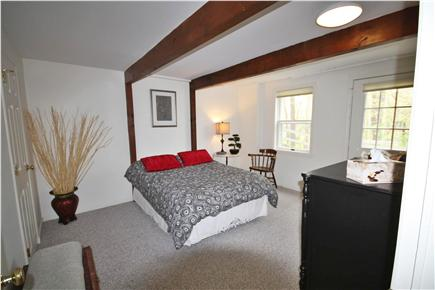 South Orleans Cape Cod vacation rental - Private access to the patio from this bedroom with a queen bed.