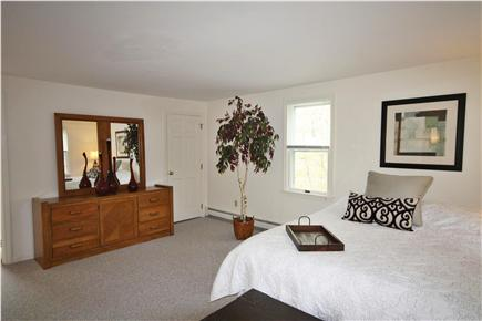 South Orleans Cape Cod vacation rental - Spacious Ensuite bedroom with king bed complete with ceiling fan.