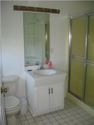 West Yarmouth Cape Cod vacation rental - Spacious Bathroom has vanity and corner cabinet/shelves.