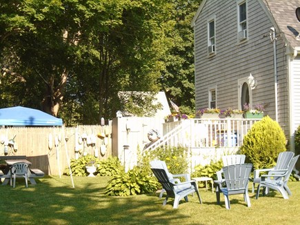 Bourne, Monument Beach Cape Cod vacation rental - Guests' barbeque area with picnic table under well lit gazebo