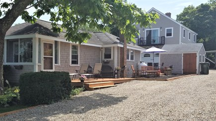 Kingston, Plymouth Area MA vacation rental - Sunny yard with deck for hanging out.