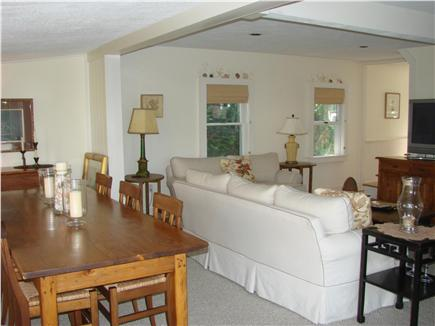Barnstable Cape Cod vacation rental - Living room with two large sofas and a large dining table.