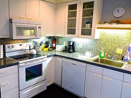 Falmouth, Woods Hole/Sippewissett/Gunnin Cape Cod vacation rental - A full, well equipped kitchen is concealed behind folding doors