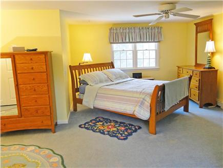 Dennis Village Cape Cod vacation rental - Upstairs master with queen bed, flat-screen tv, and private bath