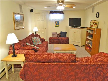 Dennis Village Cape Cod vacation rental - Basement TV alcove: comfy couches, blankets, books, and games!