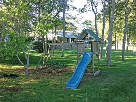 Hyannisport Cape Cod vacation rental - Spacious back yard with play set, putting green