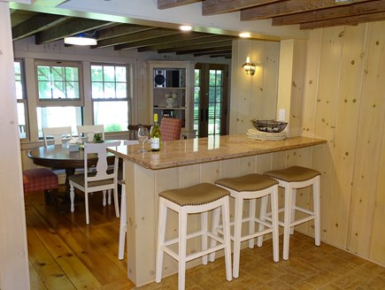 Hyannisport Cape Cod vacation rental - New kitchen island w/ seating for 6 overlooks dining, water view