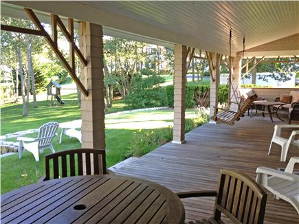 Hyannisport Cape Cod vacation rental - Large deck facing back yard, seating for dining