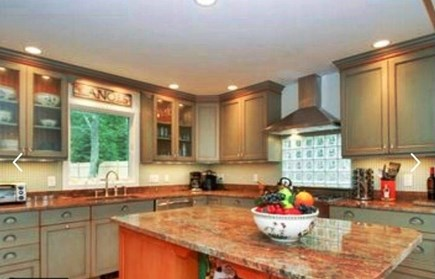 Harwich Cape Cod vacation rental - Kitchen with granite countertops and stainless steel appliances.