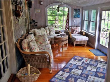 West Falmouth Cape Cod vacation rental - Sunny screened-in porch leading to a raised back deck & grill