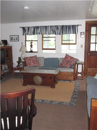 Eastham Cape Cod vacation rental - livingroom, door to enclosed porch with ceiling fan