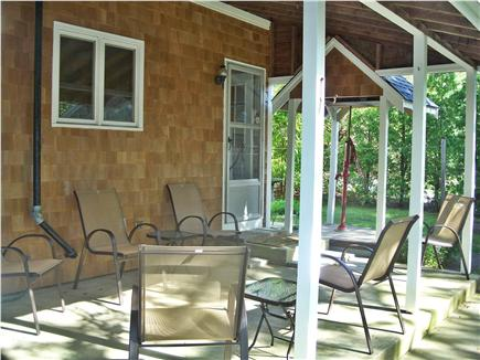 Cotuit Cape Cod vacation rental - Back patio with grill, sitting area, picnic table.