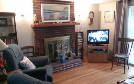 Cotuit Cape Cod vacation rental - Living Room with fireplace and attached sunroom