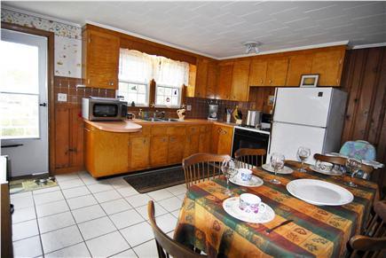 Dennisport Cape Cod vacation rental - Spacious well equipped eat-in kitchen opens to deck.