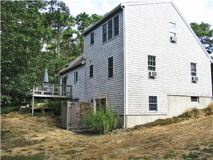 Eastham Cape Cod vacation rental - Rear elevation showing deck, outdoor shower & basement entry