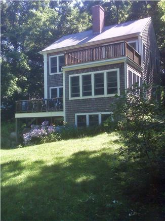 West Falmouth Cape Cod vacation rental - Yard to play in; peek at water from upstairs
