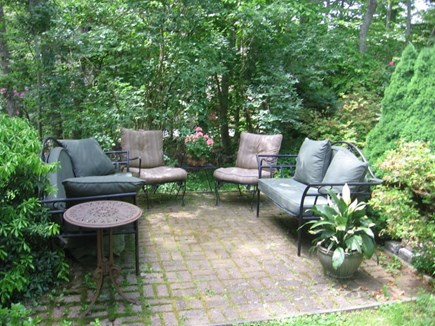 West Falmouth Cape Cod vacation rental - Large brick patio with wrought iron furniture