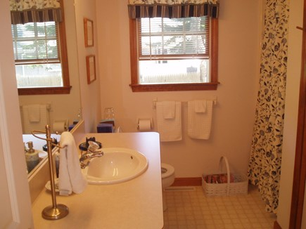 Harwich Cape Cod vacation rental - First Floor bathroom with shower and laundry area