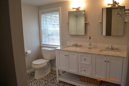 West Dennis Cape Cod vacation rental - New Bathroom with double vanity, tile shower and floors.