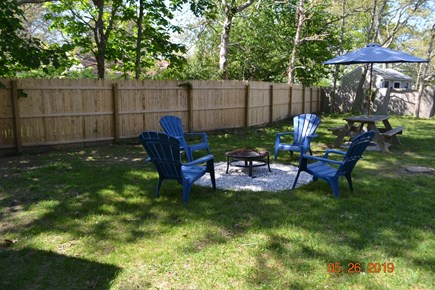 West Dennis Cape Cod vacation rental - Fire pit, picnic table and huge backyard.