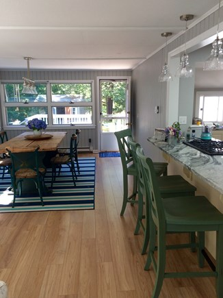 Cotuit Cotuit vacation rental - Stools and dining area off kitchen.