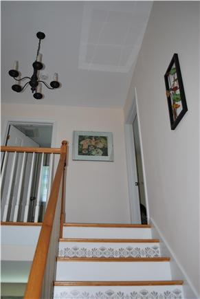 East Falmouth Cape Cod vacation rental - Vaulted entryway; stairs leading to three bedrooms and full bath