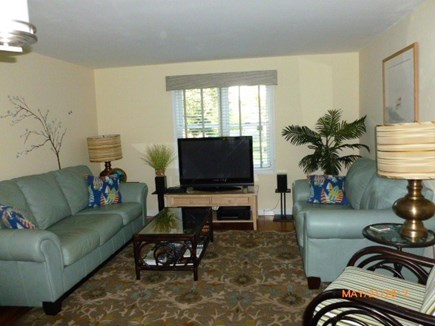 East Falmouth Cape Cod vacation rental - Bright Living Room; cozy, 42'' plasma TV with DVD and Cable TV