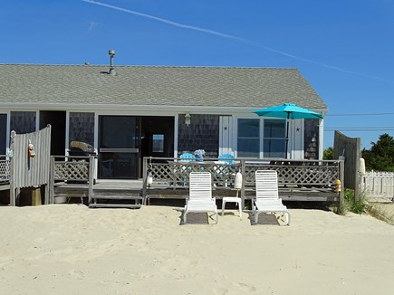 West Dennis Cape Cod vacation rental - View from beach of back of house, deck w/ grill, lounging chairs