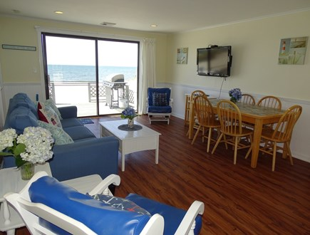 West Dennis Cape Cod vacation rental - Living area with TV, slider to deck, water views