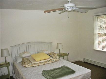 Dennis Cape Cod vacation rental - Second floor back bedroom (one queen bed & T.V./dvd player)